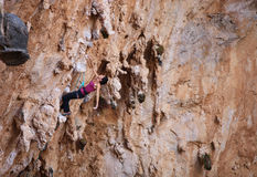 Female rock climber on a cliff face. Caucasian female rock climber on a cliff face stock photos