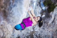 Female rock climber on a cliff face Royalty Free Stock Image