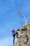 Female rock climber on a cliff. Royalty Free Stock Photos