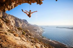 Female rock climber falling of a cliff Royalty Free Stock Photography