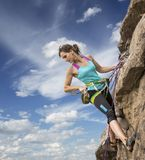 Female rock climber hanging over the abyss Royalty Free Stock Photos