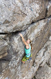 Female rock climber hanging over the abyss Royalty Free Stock Photography