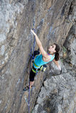 Female rock climber hanging over the abyss Royalty Free Stock Image