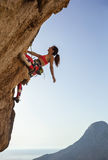 Female rock climber looking up at challenging route Stock Photos