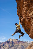 Female Rock Climber Reaching For The Summit. Royalty Free Stock Photography