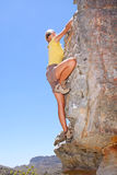 Female rock climber on steep wall Stock Images