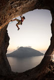 Female rock climber at sunset Stock Images