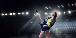 Female rock guitarist . Mixed media Stock Photos