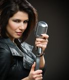 Female rock musician holding microphone Stock Image