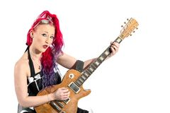 Female singer with red hair with a guitar royalty free stock image