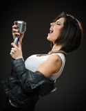 Female rock singer handing mic stock photos