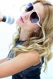 Female Rock Star. A Female Rock Star singing and jamming Royalty Free Stock Photo