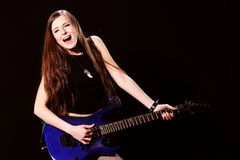 Female rock star playing the guitar Stock Images