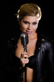 Female rocksinger with retro microphone Royalty Free Stock Photography