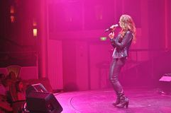Female rockstar singer performing show. Private Stock cover band performing guest entertainer show on board cruise ship Liberty of the Seas Royalty Free Stock Photography