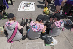 Female roller skaters from the Toronto Roller. Derby preparing to for the procession at the Toronto Gay Pride festival Royalty Free Stock Photo