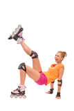 Female rollerblader kicking in the air. Stock Photo