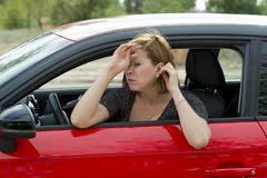 Female rookie new driver young beautiful woman scared and stressed while driving car in fear and shock Stock Image