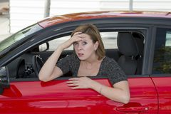 Female rookie new driver young beautiful woman scared and stressed while driving car in fear and shock Stock Photography