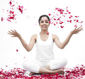 Female with rose petals. Asian female with rose petals stock images