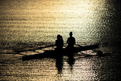 Female Rowers on Sunset Lake Stock Photo