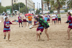 Female rugby beach Stock Photography