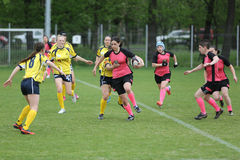 Female rugby players in action Stock Photos