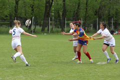 Female rugby players in action Stock Photography