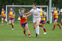 Female rugby players in action royalty free stock photography