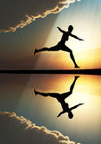 Female runner. Young woman running in the dawn as symbol of fitness and health Stock Photography
