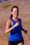 Female Runner. Beautiful asian woman runner on a bright afternoon stock photos