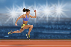 Female Runner in Action Stock Photo