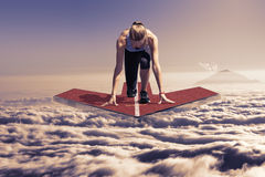 Female runner arrow platform above clouds late sunset Royalty Free Stock Image