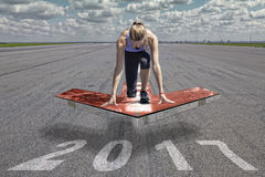 Female runner arrow platform 2017 stock photos