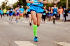 Female runner athlete. Run ahead of group runners royalty free stock image