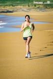 Female runner on beach Royalty Free Stock Image