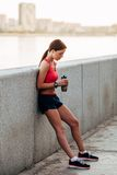 Female runner with bottled water Royalty Free Stock Images