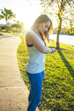Female runner checking her fitness watch device before a run Royalty Free Stock Photos