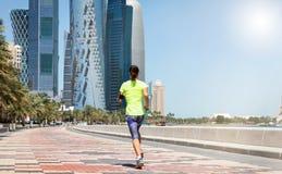 Female runner in Doha, Qatar stock photo