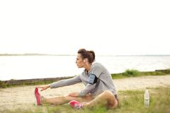 Female Runner Doing Stretching Outside Royalty Free Stock Photo