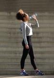 Female runner drinking from water bottle Stock Image
