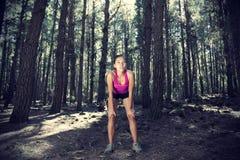 Female runner in forest stock image