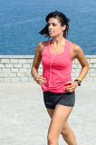 Female runner in front of sea Royalty Free Stock Image