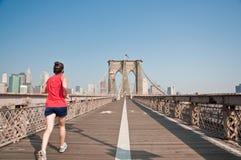 Female runner going though Brooklyn Bridge. A person running through Brookly Bridge Royalty Free Stock Photo