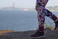 Female Runner with The Golden Gate Bridge royalty free stock photos