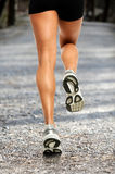 Female Runner on Gravel Road Royalty Free Stock Photo