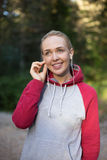 Female runner in hoody is jogging in nature Royalty Free Stock Images