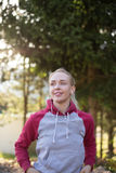 Female runner in hoody is jogging in nature Stock Image