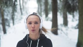 Female Runner Jogging In Cold Winter Forest stock video