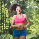 Female Runner Jogging during Outdoor workout Stock Images